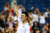 Kei Nishikori of Japan celebrates defeating Milos Raonic of Canada on Day Eight of the 2014 US Open at the USTA Billie Jean King National Tennis...