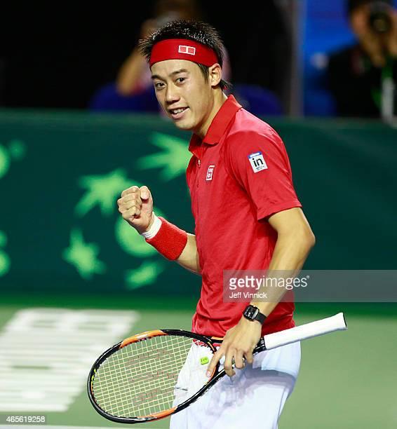 Kei Nishikori of Japan celebrates his Davis Cup match win against Milos Raonic of Canada March 8 2015 in Vancouver British Columbia Canada Nishikori...