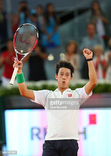 Kei Nishikori of Japan celebrates his three victory against David Ferrer of Spain in their semi final match during day eight of the Mutua Madrid Open...