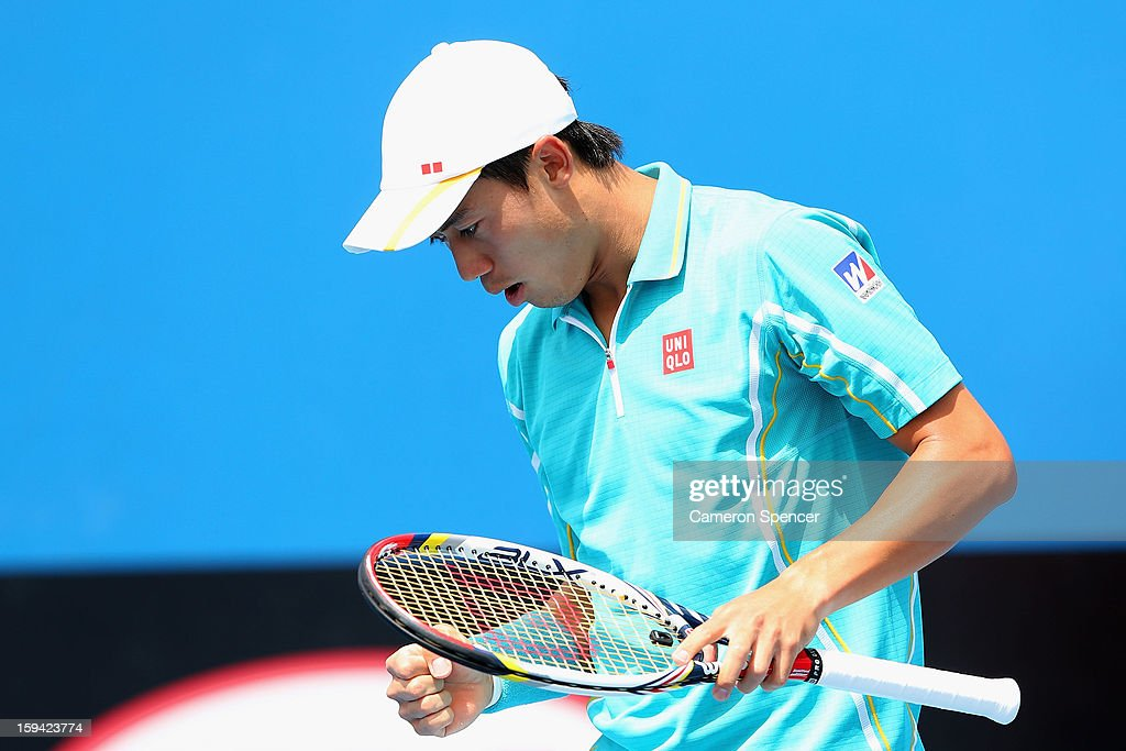 Kei Nishikori of Japan celebrates in his first round match against Victor Hanescu of Romania during day one of the 2013 Australian Open at Melbourne Park on January 14, 2013 in Melbourne, Australia.