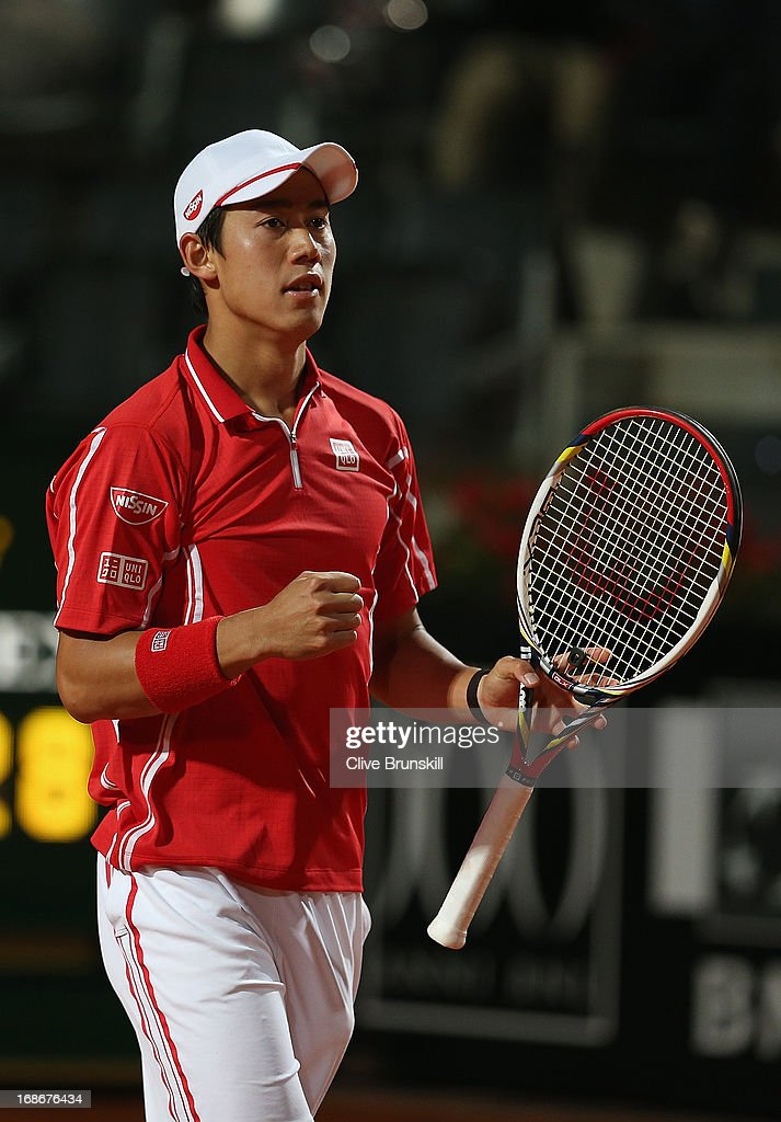<a gi-track='captionPersonalityLinkClicked' href=/galleries/search?phrase=Kei+Nishikori&family=editorial&specificpeople=4432498 ng-click='$event.stopPropagation()'>Kei Nishikori</a> of Japan celebrates match point against Paolo Lorenzi of Italy in their first round match during day two of the Internazionali BNL d'Italia 2013 at the Foro Italico Tennis Centre on May 13, 2013 in Rome, Italy.