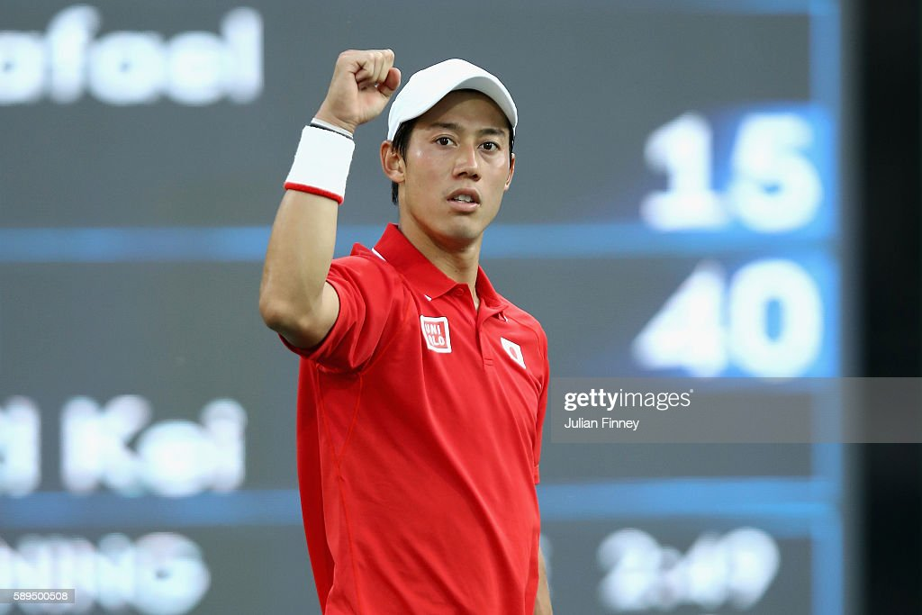 Kei Nishikori of Japan celebrates match point to win the singles bronze medal match against Rafael Nadal of Spain on Day 9 of the Rio 2016 Olympic Games at the Olympic Tennis Centre on August 14, 2016 in Rio de Janeiro, Brazil.
