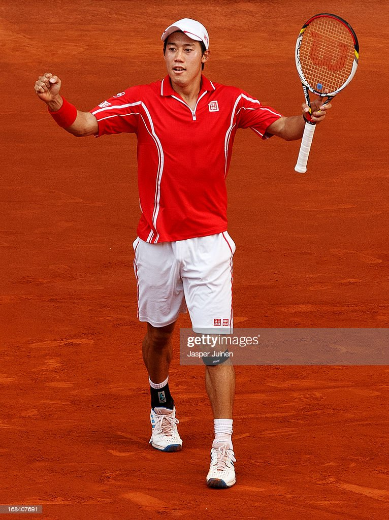 Kei Nishikori of Japan celebrates matchpoint after winning his match against <a gi-track='captionPersonalityLinkClicked' href=/galleries/search?phrase=Roger+Federer&family=editorial&specificpeople=157480 ng-click='$event.stopPropagation()'>Roger Federer</a> of Switzerland on day six of the Mutua Madrid Open tennis tournament at the Caja Magica on May 9, 2013 in Madrid, Spain.