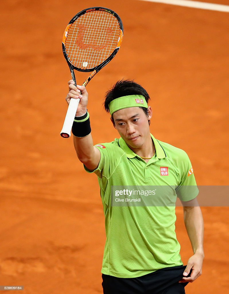<a gi-track='captionPersonalityLinkClicked' href=/galleries/search?phrase=Kei+Nishikori&family=editorial&specificpeople=4432498 ng-click='$event.stopPropagation()'>Kei Nishikori</a> of Japan celebrates to the crowd after his three set victory against Nick Kyrgios of Australia in their quarter final round match during day seven of the Mutua Madrid Open tennis tournament at the Caja Magica on May 06, 2016 in Madrid,Spain.