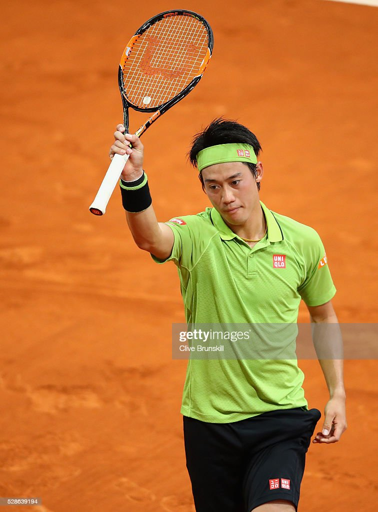 Kei Nishikori of Japan celebrates to the crowd after his three set victory against Nick Kyrgios of Australia in their quarter final round match during day seven of the Mutua Madrid Open tennis tournament at the Caja Magica on May 06, 2016 in Madrid,Spain.