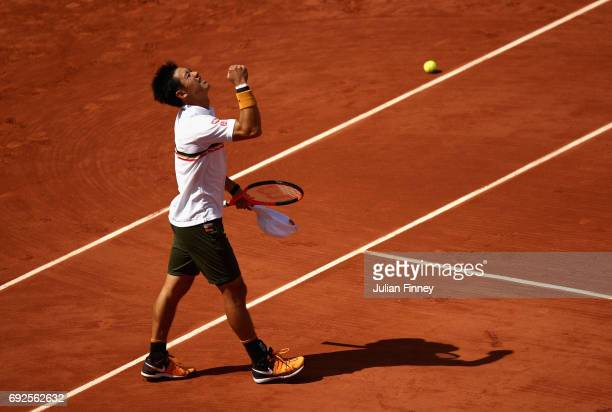 Kei Nishikori of Japan celebrates victory in the mens singles fourth round match against Ferdando Verdasco of Spain on day nine of the 2017 French...