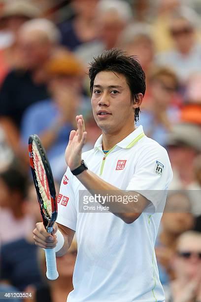 Kei Nishikori of Japan celebrates winning his match against Bernard Tomic of Australia during day six of the 2015 Brisbane International at Pat...
