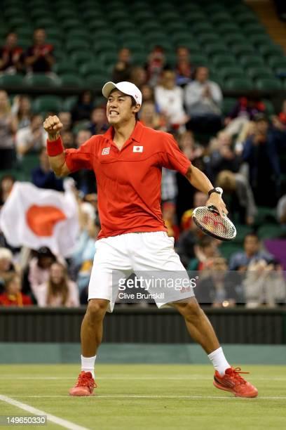 Kei Nishikori of Japan celebrates winning his third round Men's Singles Tennis match against David Ferrer of Spain on Day 5 of the London 2012...