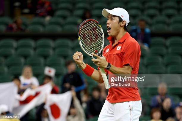 Kei Nishikori of Japan celebrates winning his third round Men's Singles Tennis match against David Ferrer of Spain on Day 5 of the London 2012...