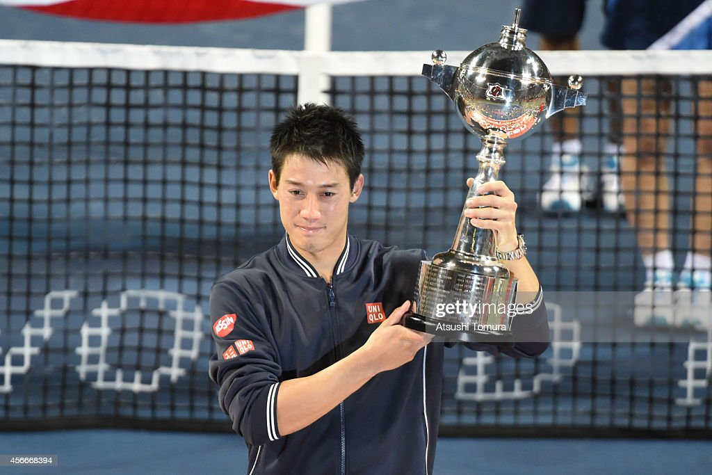 Kei Nishikori of Japan celebrates with his trophy after the men's singles final match against Milos Raonic of Canada on day seven of Rakuten Open 2014 at Ariake Colosseum on October 5, 2014 in Tokyo, Japan.