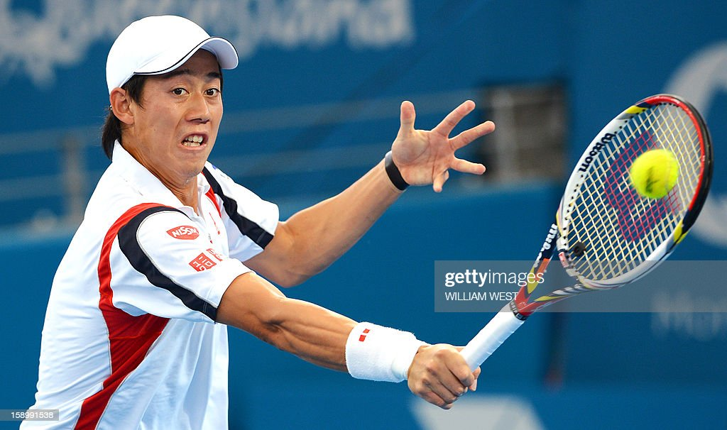 Kei Nishikori of Japan hits a backhand return before retiring injured from his semi-final match against Andy Murray of Britain at the Brisbane International tennis tournament on January 5, 2013. AFP PHOTO/William WEST USE