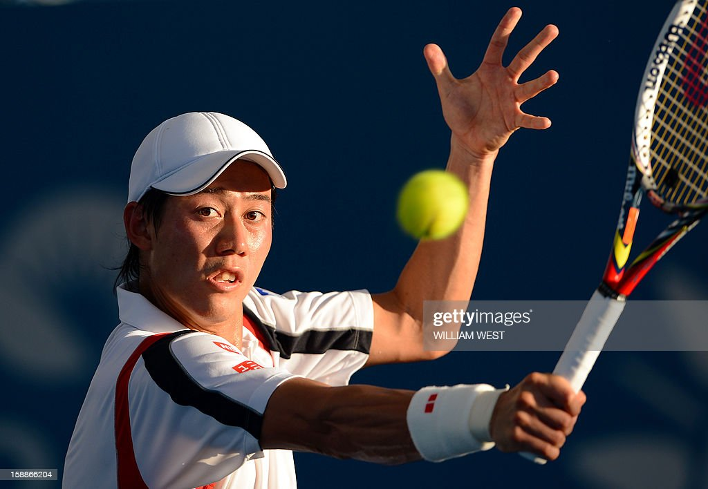Kei Nishikori of Japan hits a backhand return during his victory over Tommy Robredo of Spain in the second round at the Brisbane International tennis tournament on January 2, 2013. AFP PHOTO/William WEST USE