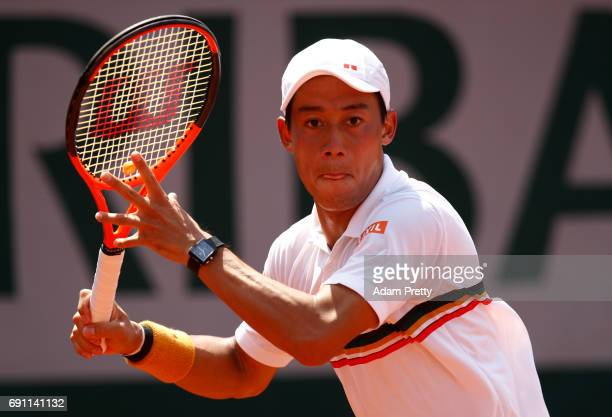 Kei Nishikori of Japan hits a forehand during the men's singles second round match against Jeremy Chardy of France on day five of the 2017 French...