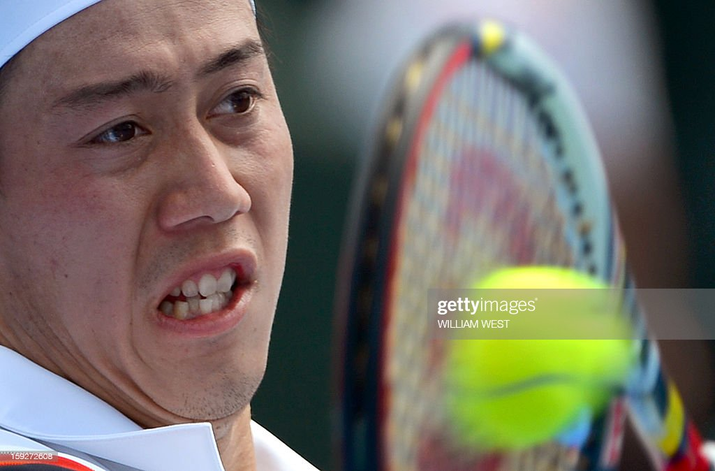 Kei Nishikori of Japan hits a forehand return against Paul-Henri Mathieu of France during his match at the Kooyong Classic in Melbourne on January 11, 2013. AFP PHOTO/William WEST USE