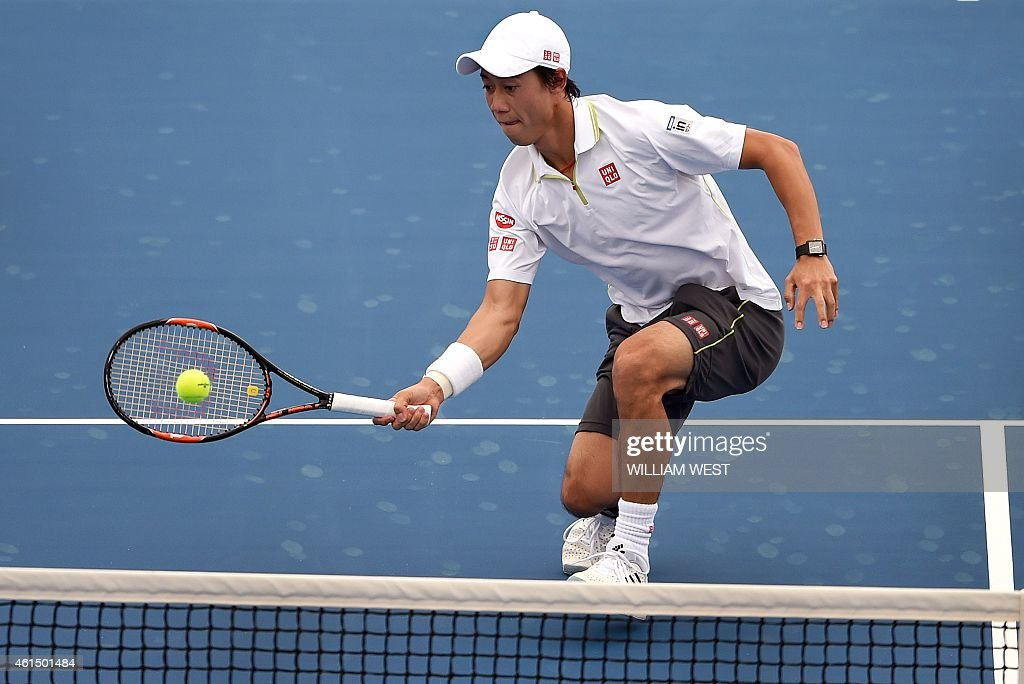 Kei Nishikori of Japan hits a return against Jordan Thompson of Australia during their men's singles match at the Kooyong Classic tennis event in...
