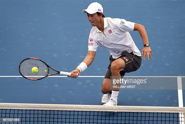 Kei Nishikori of Japan hits a return against Jordan Thompson of Australia during their men's singles match at the Kooyong Classic tennis event in...