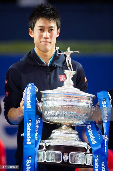 Kei Nishikori of Japan holds the trophy of the Barcelona Open Banc Sabadell after defeating Pablo Andujar of Spain on the final match during day...