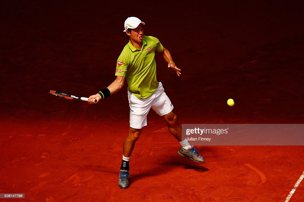 <a gi-track='captionPersonalityLinkClicked' href=/galleries/search?phrase=Kei+Nishikori&family=editorial&specificpeople=4432498 ng-click='$event.stopPropagation()'>Kei Nishikori</a> of Japan in action against Fabio Fognini of Italy during day five of the Mutua Madrid Open tennis tournament at the Caja Magica on May 04, 2016 in Madrid, Spain.