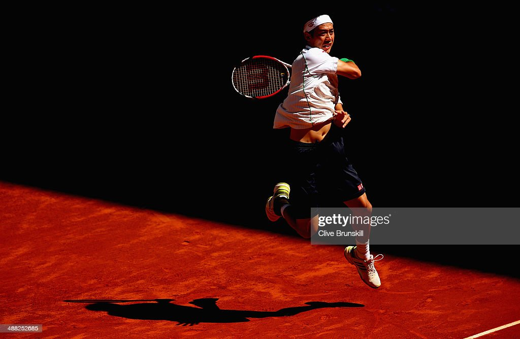 <a gi-track='captionPersonalityLinkClicked' href=/galleries/search?phrase=Kei+Nishikori&family=editorial&specificpeople=4432498 ng-click='$event.stopPropagation()'>Kei Nishikori</a> of Japan in action against Ivan Dodig of Croatia in their first round match during day three of the Mutua Madrid Open tennis tournament at the Caja Magica on May 5, 2014 in Madrid, Spain.