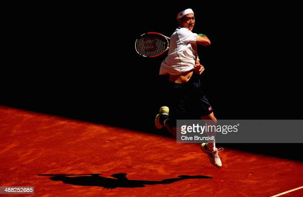 Kei Nishikori of Japan in action against Ivan Dodig of Croatia in their first round match during day three of the Mutua Madrid Open tennis tournament...