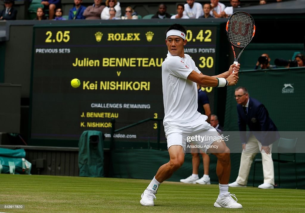 Kei NIshikori of Japan in action against Julien Benneteau (not seen) of France in the men's singles on day four of the 2016 Wimbledon Championships at the All England Lawn and Croquet Club in London, United Kingdom on June 30, 2016.