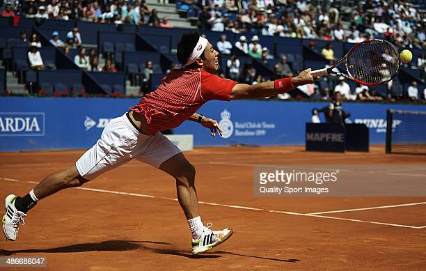 Kei Nishikori of Japan in action against Marin Cilic of Croatia during day five of the ATP Barcelona Open Banc Sabadell at the Real Club de Tenis...