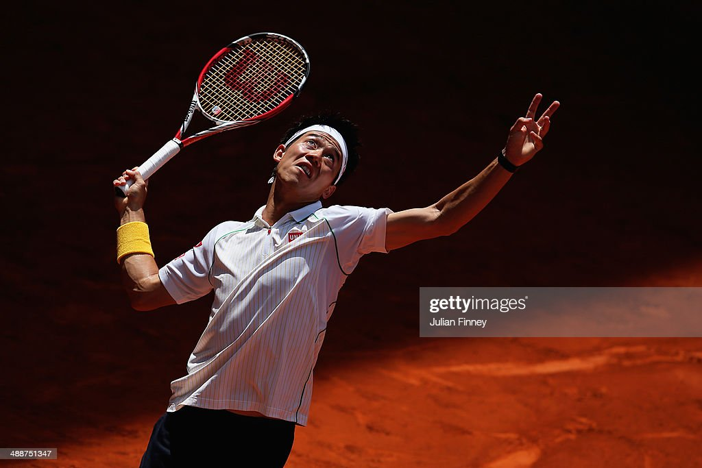 <a gi-track='captionPersonalityLinkClicked' href=/galleries/search?phrase=Kei+Nishikori&family=editorial&specificpeople=4432498 ng-click='$event.stopPropagation()'>Kei Nishikori</a> of Japan in action against Milos Raonic of Canada during day six of the Mutua Madrid Open tennis tournament at the Caja Magica on May 8, 2014 in Madrid, Spain.