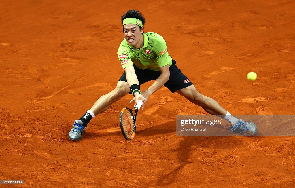 <a gi-track='captionPersonalityLinkClicked' href=/galleries/search?phrase=Kei+Nishikori&family=editorial&specificpeople=4432498 ng-click='$event.stopPropagation()'>Kei Nishikori</a> of Japan in action against Nick Kyrgios of Australia in their quarter final round match during day seven of the Mutua Madrid Open tennis tournament at the Caja Magica on May 06, 2016 in Madrid,Spain.
