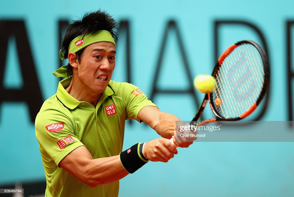 Kei Nishikori of Japan in action against Richard Gasquet of France in their third round match during day six of the Mutua Madrid Open tennis tournament at the Caja Magica on May 05, 2016 in Madrid,Spain