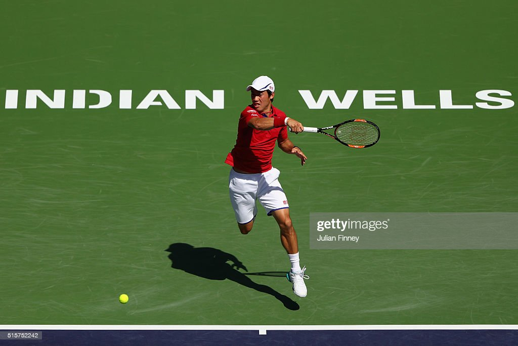 Kei Nishikori of Japan in action against Steve Johnson of USA during day nine of the BNP Paribas Open at Indian Wells Tennis Garden on March 15, 2016 in Indian Wells, California.