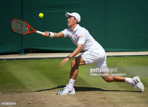 Kei Nishikori of Japan in action during his defeat by Roberto Bautista Agut of Spain in their Men's Singles Third Round Match at Wimbledon on July 7...