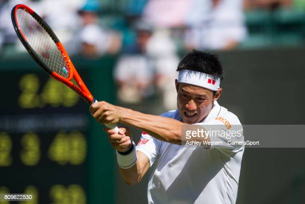 Kei Nishikori of Japan in action during his victory over Sergiy Stakhovsky of Ukraine in their Men's Singles Second Round Match at Wimbledon on July...