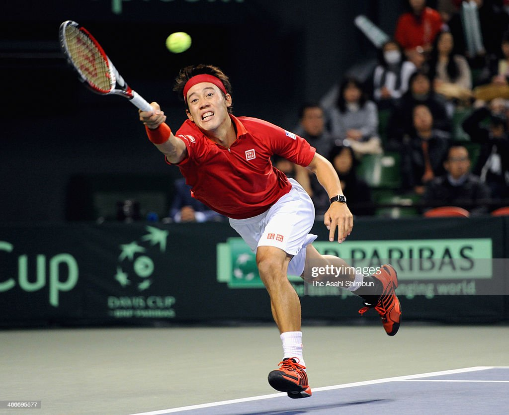 <a gi-track='captionPersonalityLinkClicked' href=/galleries/search?phrase=Kei+Nishikori&family=editorial&specificpeople=4432498 ng-click='$event.stopPropagation()'>Kei Nishikori</a> of Japan in action in a match against Canada during the Davis Cup at Ariake Colosseum on February 2, 2014 in Tokyo, Japan.