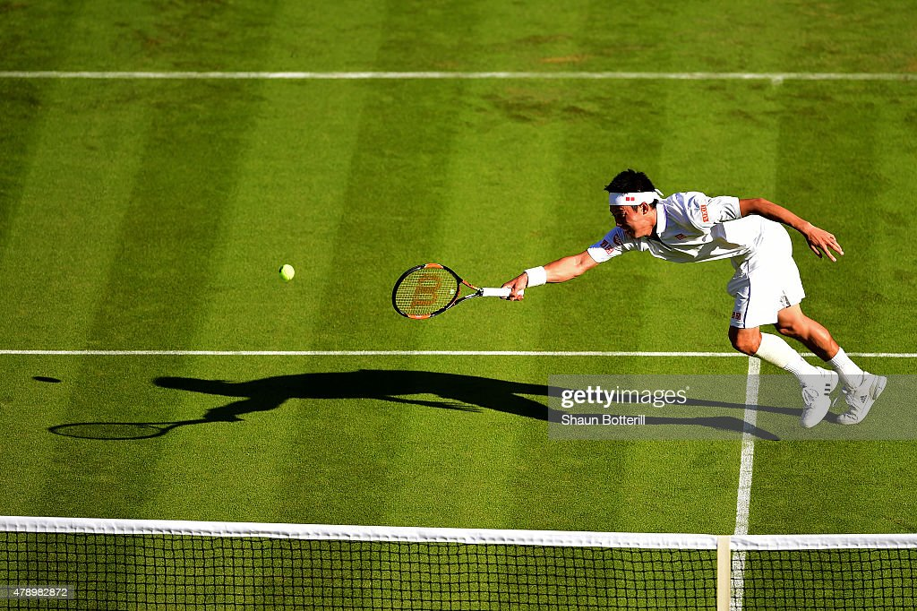 Kei Nishikori of Japan in action in his Gentlemen's Singles first round match against Simone Bolelli of Italy during day one of the Wimbledon Lawn Tennis Championships at the All England Lawn Tennis and Croquet Club on June 29, 2015 in London, England.