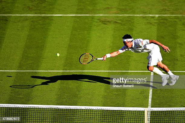 Kei Nishikori of Japan in action in his Gentlemen's Singles first round match against Simone Bolelli of Italy during day one of the Wimbledon Lawn...
