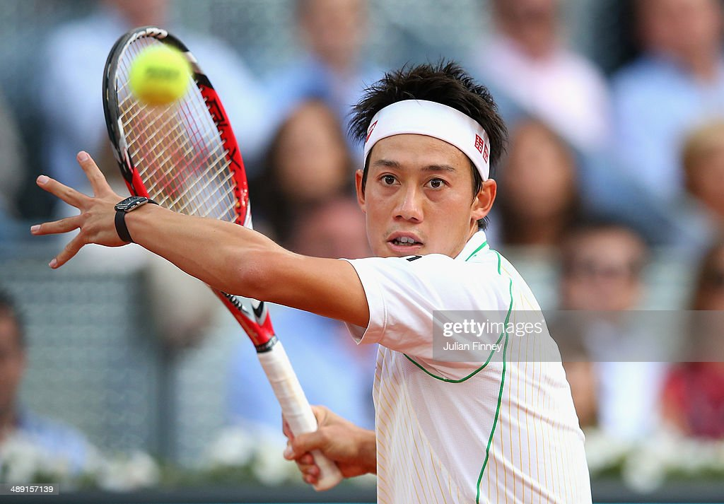 <a gi-track='captionPersonalityLinkClicked' href=/galleries/search?phrase=Kei+Nishikori&family=editorial&specificpeople=4432498 ng-click='$event.stopPropagation()'>Kei Nishikori</a> of Japan in action in his match against David Ferrer of Spain during day eight of the Mutua Madrid Open tennis tournament at the Caja Magica on May 10, 2014 in Madrid, Spain.