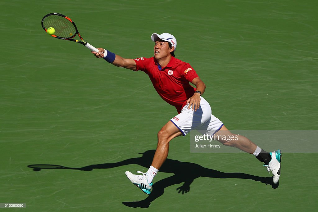 Kei Nishikori of Japan in action in his match against Rafael Nadal of Spain during day twelve of the BNP Paribas Open at Indian Wells Tennis Garden on March 18, 2016 in Indian Wells, California.