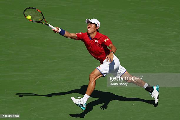 Kei Nishikori of Japan in action in his match against Rafael Nadal of Spain during day twelve of the BNP Paribas Open at Indian Wells Tennis Garden...