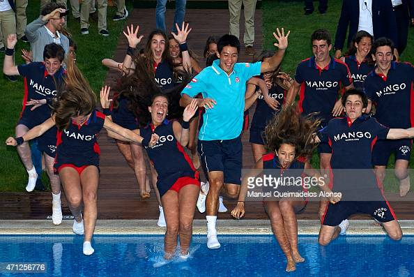 Kei Nishikori of Japan is thrown into the pool after his victory against Pablo Andujar of Spain in the final during day seven of the Barcelona Open...