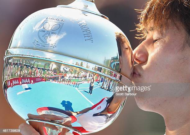 Kei Nishikori of Japan kisses the Kooyong Classic trophy after winning his match against Tomas Berdych of the Czech Republic in the final during day...