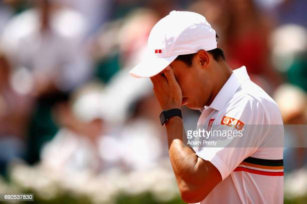 Kei Nishikori of Japan looks dejected during mens singles fourth round match against Ferdando Verdasco of Spain on day nine of the 2017 French Open...