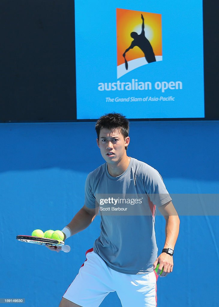 <a gi-track='captionPersonalityLinkClicked' href=/galleries/search?phrase=Kei+Nishikori&family=editorial&specificpeople=4432498 ng-click='$event.stopPropagation()'>Kei Nishikori</a> of Japan looks on during a practice session ahead of the 2013 Australian Open at Melbourne Park on January 9, 2013 in Melbourne, Australia.
