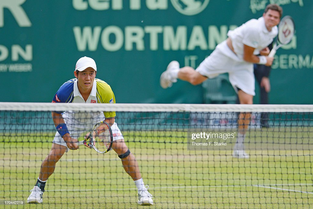 Kei Nishikori (FRONT) of Japan looks on in his doubles match with Milos Raonic (BACK) of Canada against Philipp Kohlschreiber of Germany and Mikhail Youzhny of Russia during day four of the Gerry Weber Open at Gerry Weber Stadium on June 13, 2013 in Halle, Germany.