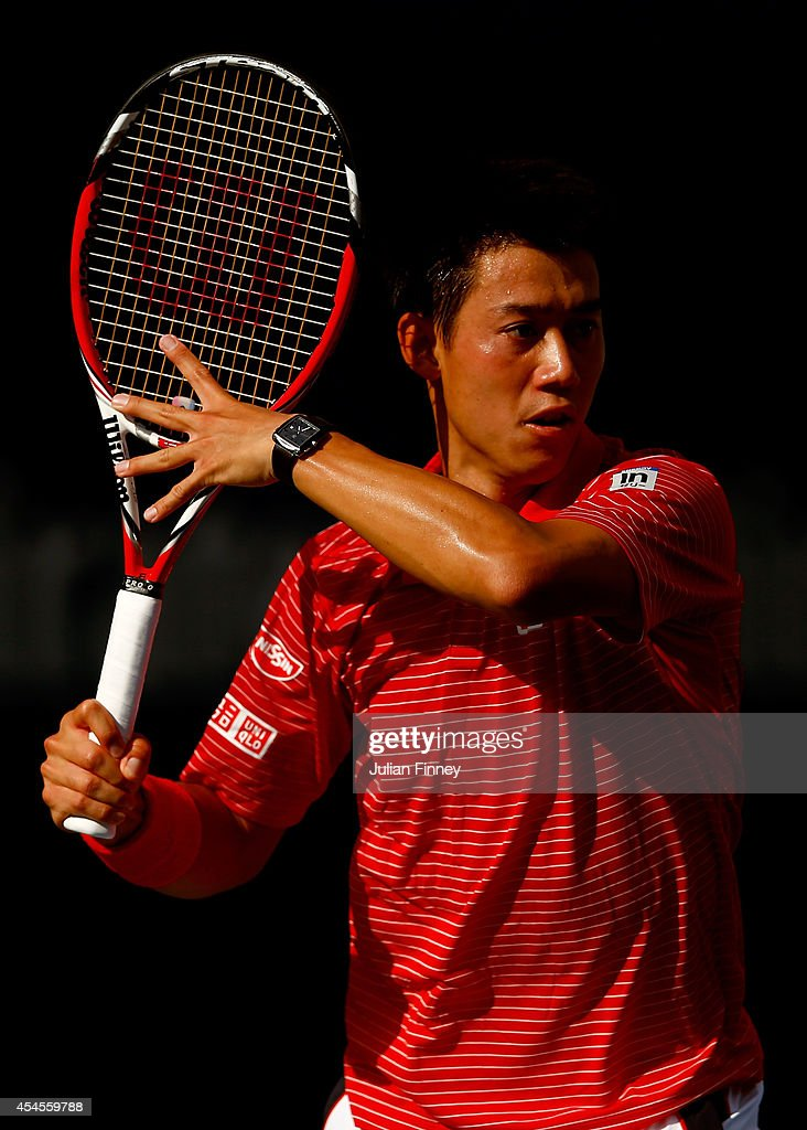Kei Nishikori of Japan looks to return a shot against Stan Wawrinka of Switzerland during their men's singles quarterfinal match on Day Ten of the 2014 US Open at the USTA Billie Jean King National Tennis Center on September 3, 2014 in the Flushing neighborhood of the Queens borough of New York City.