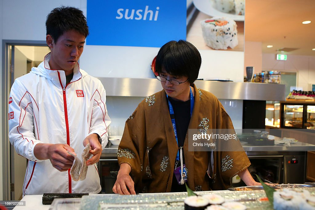 Kei Nishikori of Japan makes sushi rolls in Melbourne Park at the 2013 Australian Open at Melbourne Park on January 19, 2013 in Melbourne, Australia.