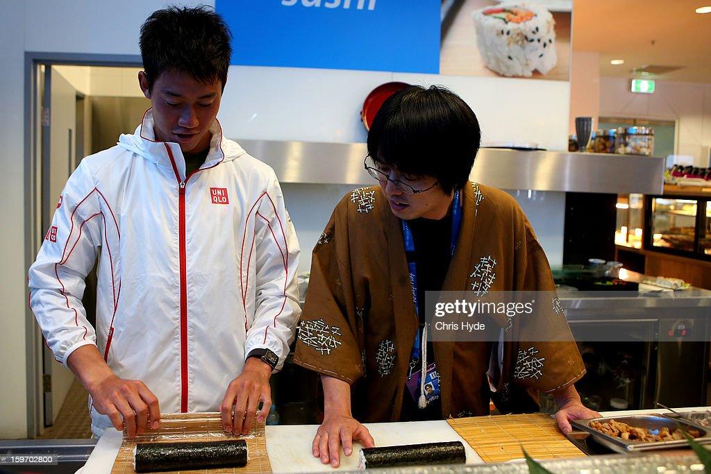 Kei Nishikori of Japan makes sushi rolls in Melbourne Park at the 2013 Australian Open at Melbourne Park on January 19, 2013 in Melbourne, Australia.