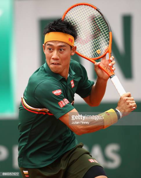 Kei Nishikori of Japan plays a awaits to return the ball during the mens singles first round match against Thanasi Kokkinakis of Australia on day...