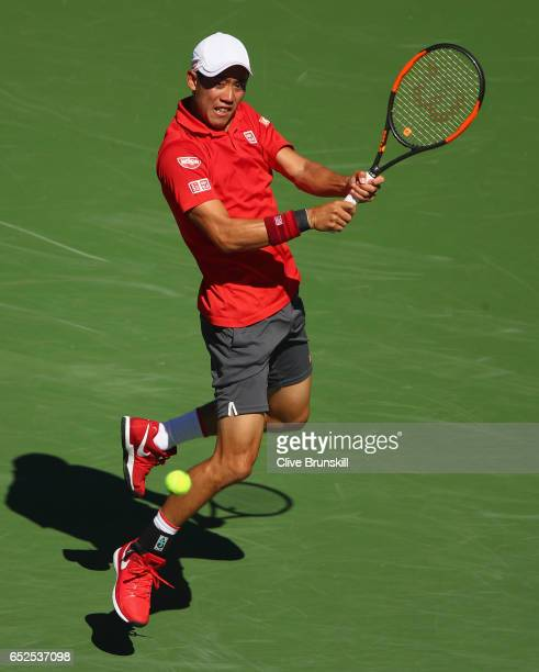 Kei Nishikori of Japan plays a backhand against Dan Evans of Great Britain in their second round match during day seven of the BNP Paribas Open at...