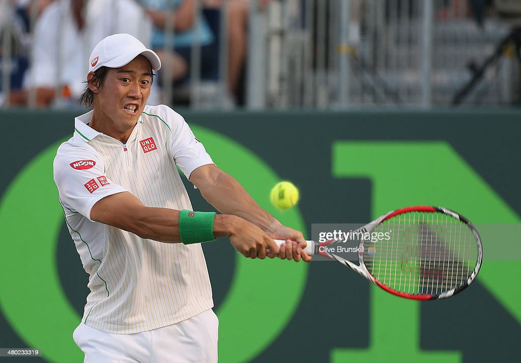 Kei Nishikori of Japan plays a backhand against <a gi-track='captionPersonalityLinkClicked' href=/galleries/search?phrase=Grigor+Dimitrov&family=editorial&specificpeople=4332557 ng-click='$event.stopPropagation()'>Grigor Dimitrov</a> of Bulgaria during their third round match during day 7 at the Sony Open at Crandon Park Tennis Center on March 23, 2014 in Key Biscayne, Florida.