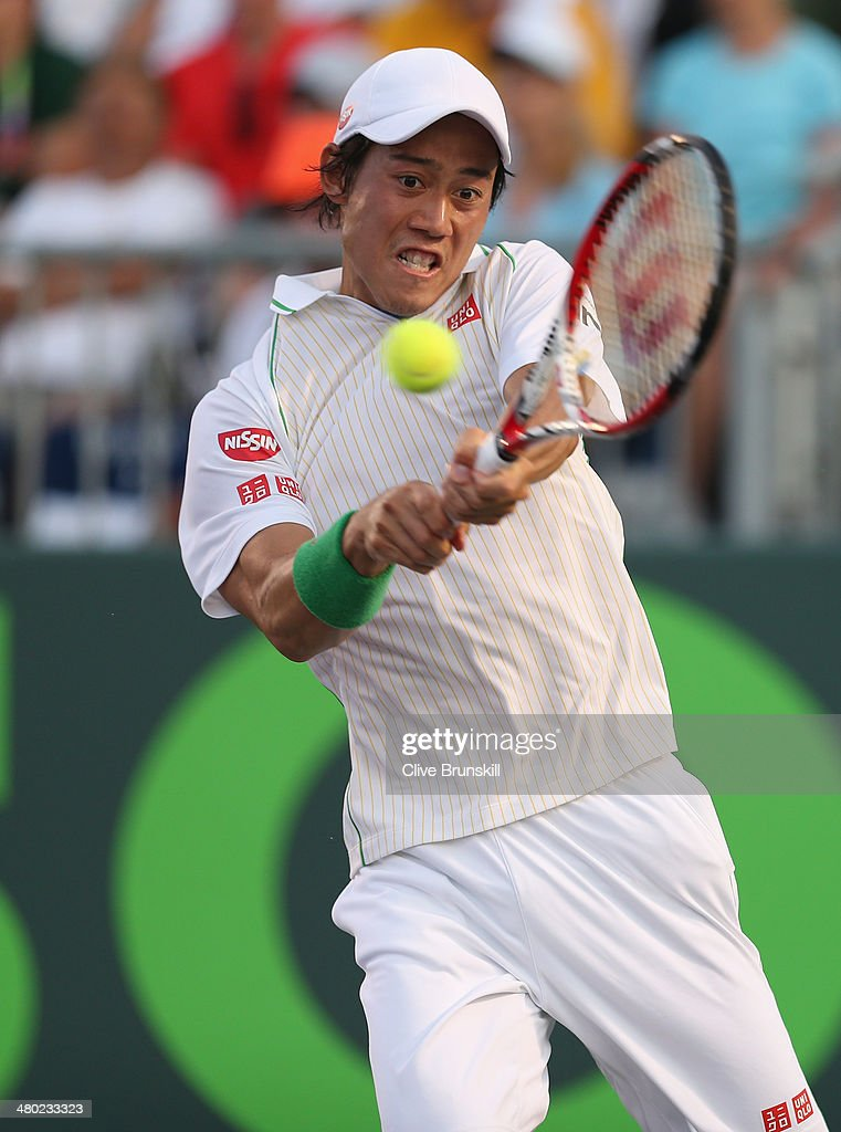 <a gi-track='captionPersonalityLinkClicked' href=/galleries/search?phrase=Kei+Nishikori&family=editorial&specificpeople=4432498 ng-click='$event.stopPropagation()'>Kei Nishikori</a> of Japan plays a backhand against Grigor Dimitrov of Bulgaria during their third round match during day 7 at the Sony Open at Crandon Park Tennis Center on March 23, 2014 in Key Biscayne, Florida.
